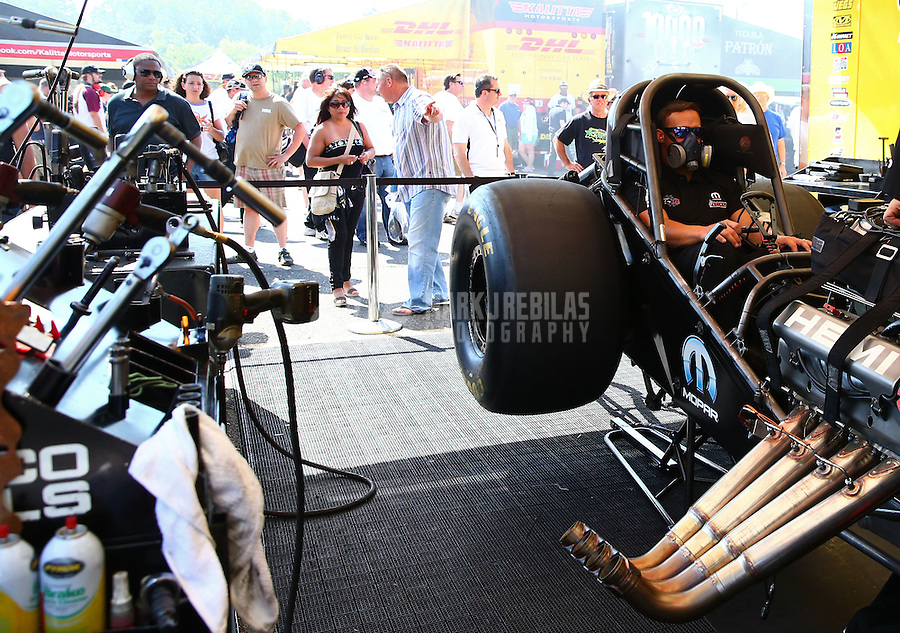 Jun. 2, 2013; Englishtown, NJ, USA: NHRA funny car driver Matt Hagan warms up his car in the pits during the Summer Nationals at Raceway Park. Mandatory Credit: Mark J. Rebilas-