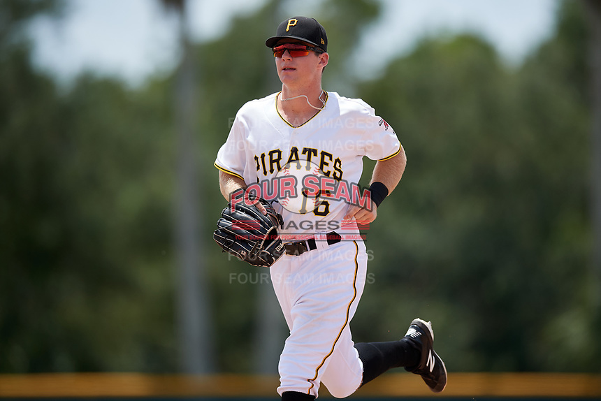 GCL Pirates center fielder Justin Harrer (16) jogs back to the dugout during a game against the GCL Tigers West on August 13, 2018 at Pirate City Complex in Bradenton, Florida.  GCL Tigers West defeated GCL Pirates 5-1.  (Mike Janes/Four Seam Images)