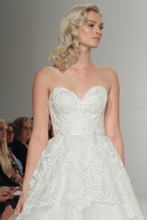 Model walks runway in a strapless lace overlay gown, from the Christian Siriano for Kleinfeld bridal collection, at Kleinfeld on April 18, 2016 during New York Bridal Fashion Week Spring Summer 2017.