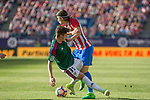 Miguel Olavide of Club Atletico Osasuna competes for the ball with Filipe Luis of Atletico de Madrid during the match of La Liga between  Atletico de Madrid and Club Atletico Osasuna at Vicente Calderon  Stadium  in Madrid, Spain. April 15, 2017. (ALTERPHOTOS / Rodrigo Jimenez)