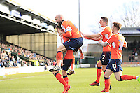 Glen Rea (far left) of Luton Town is mobbed by team mates after scoring his sides third goal during the Sky Bet League 2 match between Yeovil Town and Luton Town at Huish Park, Yeovil, England on 4 March 2017. Photo by Liam Smith / PRiME Media Images.