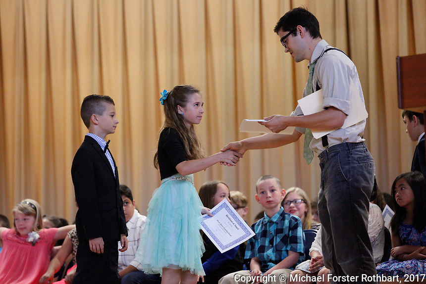 The Oneonta Greater Plains elementary school fifth grade awards ceremony, on June 21, 2017.<br /> &copy; Michael Forster Rothbart Photography<br /> www.mfrphoto.org &bull; 607-267-4893<br /> 34 Spruce St, Oneonta, NY 13820<br /> 86 Three Mile Pond Rd, Vassalboro, ME 04989<br /> info@mfrphoto.org<br /> Photo by: Michael Forster Rothbart<br /> Date:  6/21/2017<br /> File#:  Canon &mdash; Canon EOS 5D Mark III digital camera frame C19308