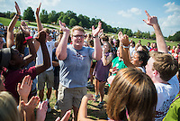 New Maroon campers and counselors enjoy Family Olympics on a hot summer day on the Club Sports Fields. New Maroon camp counselor Trevor Blood leads a group chant.<br />  (photo by Sarah Dutton / &copy; Mississippi State University)