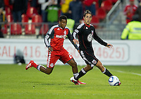 16 April 2011: D.C. United forward Josh Wolff #16 and Toronto FC defender Danleigh Borman #25 in action during an MLS game between D.C. United and the Toronto FC at BMO Field in Toronto, Ontario Canada..D.C. United won 3-0.
