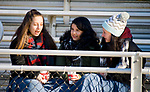 WATERTOWN, CT-112317JS16- Students Sarah Fox, left, and Rylee Reese, right, along with Emily Testone, a student from Woodland Regional High School in Beacon Falls, chat during half-time of the Watertown-Torrington Thanksgiving Day game Thursday at Watertown High School. <br /> Jim Shannon Republican-American
