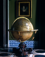 A magnificent antique globe on its original pedestal dominates the hall