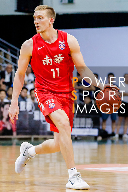 Dominic Robert Gilbert #11 of SCAA Men's Basketball Team handles the ball against the Winling during the Hong Kong Basketball League game between SCAA vs Winling at Southorn Stadium on June 19, 2018 in Hong Kong. Photo by Yu Chun Christopher Wong / Power Sport Images