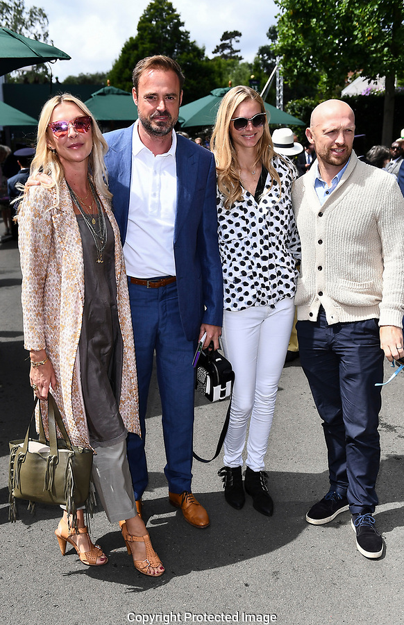 (l-r) Sophie Siegle (wife of Jamie Theakston), Jamie Theakston, Carolin Hauskeller (wife of Matt Dawson) and Matt Dawson