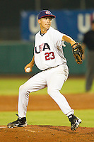 Clate Schmidt #23 of the USA 18u National Team in action against the USA Baseball Collegiate National Team at the USA Baseball National Training Center on July 2, 2011 in Cary, North Carolina.  The College National Team defeated the 18u team 8-1.  Brian Westerholt / Four Seam Images