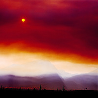 Dramatic Orange Red Sky of Smoke and Smog Layers caused by a Forest Fire in British Columbia, Canada