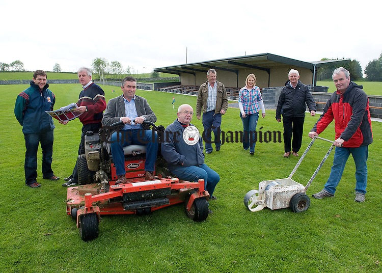 Malachy Murray, former chairman, Michael Mc Namara, secretary, Pat O Brien, chairman, Haulie Hannon treasurer, Pakie Conroy, field maintenance, Sandra Reynolds, former secretary, Des Lynch former chairman and Mike Ryan, field committee chairman, making last minute preparations for the opening of the new pitch on May 22nd May at Clooney-Quin GAA grounds. Photograph by John Kelly.