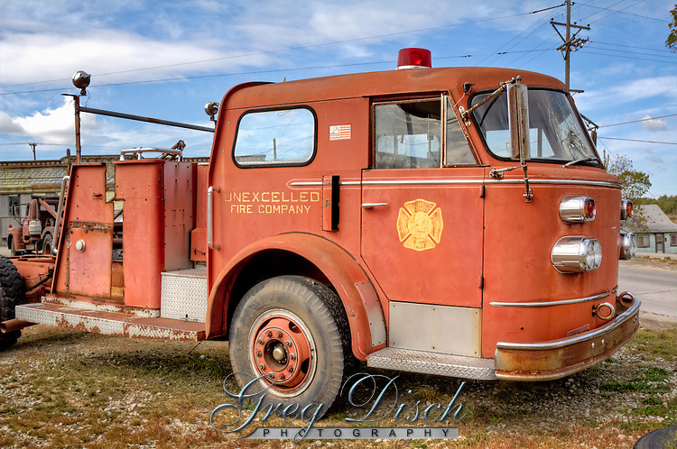 """An old fire  truck sits at the Historic Kan-O-Tex service station in Galena Kansas on route 66.  The station has been restored and is now """"4 Women on the Route"""" a sandwich and gift shop featuring route 66 and """"Car's"""" items. The station is now named """"Cars on the Route"""""""