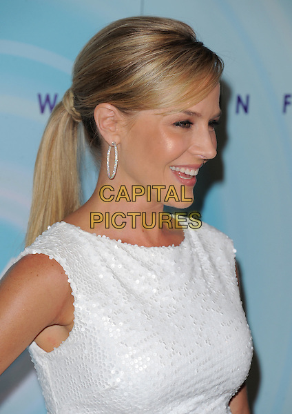 Julie Benz.2011 Women In Film Crystal + Lucy Awards held at the Beverly Hilton Hotel, Beverly Hills, California, USA..June 16th, 2011.headshot portrait white sleeveless hoop earrings profile ponytail hair beauty                                                       .CAP/RKE/DVS.©DVS/RockinExposures/Capital Pictures.