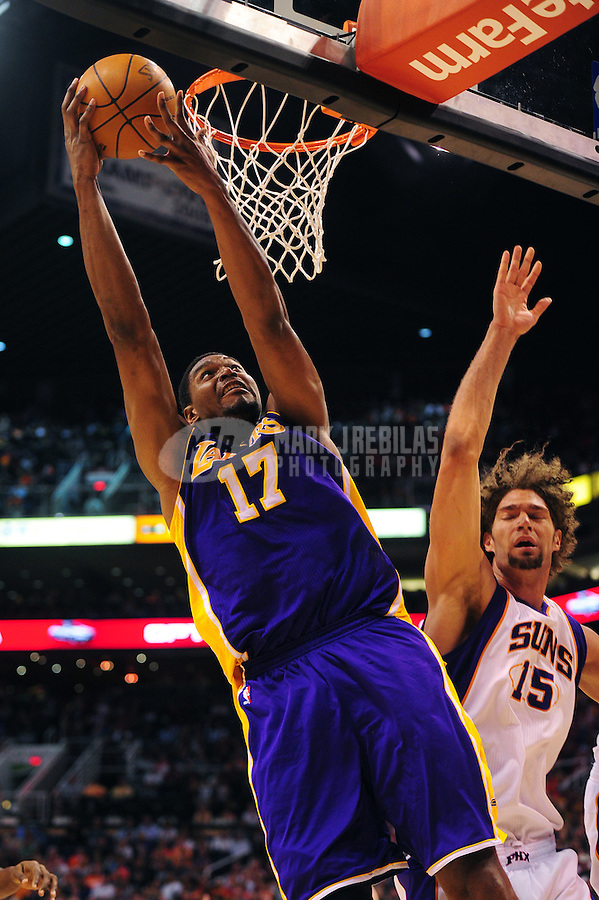 Apr. 7, 2012; Phoenix, AZ, USA; Los Angeles Lakers center (17) Andrew Bynum grabs a rebound under pressure from Phoenix Suns center (15) Robin Lopez in the first half at the US Airways Center. The Suns defeated the Lakers 125-105.  Mandatory Credit: Mark J. Rebilas-.