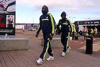 Wednesday 18 September 2013<br /> Pictured L-R: Roland Lamah and Wilfried Bony entering Cardiff Airport. <br /> Re: Swansea City FC players and staff travelling to Spain for their UEFA Europa League game against Valencia.