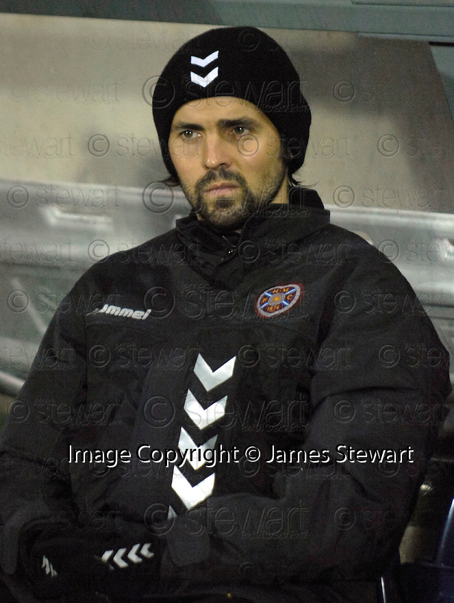 13/11/2006       Copyright Pic: James Stewart.File Name :sct_jspa18_falkirk_v_hearts.PAUL HARTLEY TAKES HIS SEAT IN THE DUG OUT.James Stewart Photo Agency 19 Carronlea Drive, Falkirk. FK2 8DN      Vat Reg No. 607 6932 25.Office     : +44 (0)1324 570906     .Mobile   : +44 (0)7721 416997.Fax         : +44 (0)1324 570906.E-mail  :  jim@jspa.co.uk.If you require further information then contact Jim Stewart on any of the numbers above.........