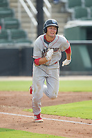 Mitch Walding (22) of the Lakewood BlueClaws hustles down the first base line against the Kannapolis Intimidators at CMC-NorthEast Stadium on July 20, 2014 in Kannapolis, North Carolina.  The Intimidators defeated the BlueClaws 7-6. (Brian Westerholt/Four Seam Images)