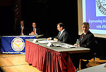 Old Westbury, New York, U.S. 8th October 2013. Republican EDWARD MANGANO, the Nassau County Executive, and Democrat THOMAS SUOZZI, the former County Executive, R-L at red table, face each other in a debate hosted by the Nassau County Village Officials Association, representing 64 incorporated villages with 450,000 residents, as the opponents face a rematch in the 2013 November elections.