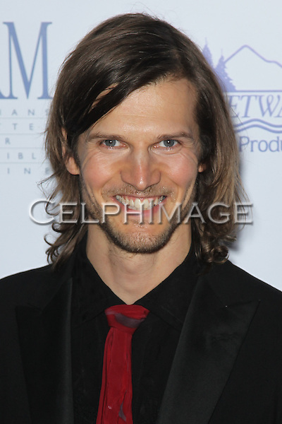 DREW BROADRICK. Red Carpet arrivals to The Art of Compassion PCRM 25th Anniversary Gala at The Lot in West Hollywood. West Hollywood, CA, USA. April 10, 2010.