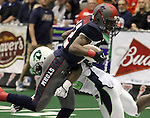 SIOUX FALLS, SD - FEBRUARY 21:  Troy Harrison #22 from the Sioux Falls Storm tries to get past a defender from the Nebraska Danger in the second quarter of their game Friday night at the Sioux Falls Arena. (Photo by Dave Eggen/Inertia)