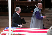 Former United States President George W. Bush walks past the casket to deliver the eulogy at the National funeral service in honor of the late former United States President George H.W. Bush at the Washington National Cathedral in Washington, DC on Wednesday, December 5, 2018.<br /> Credit: Ron Sachs / CNP<br /> (RESTRICTION: NO New York or New Jersey Newspapers or newspapers within a 75 mile radius of New York City)