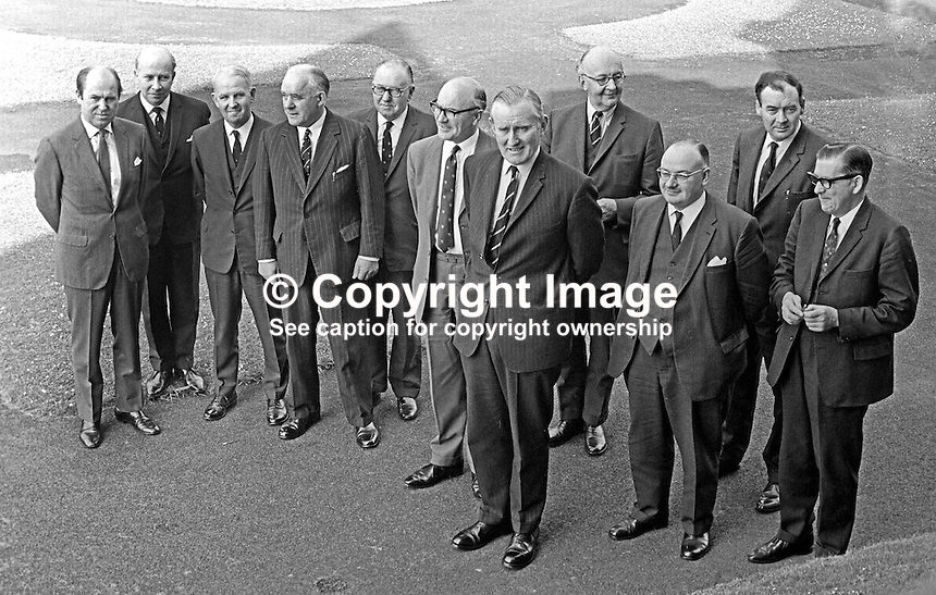 The new N Ireland Unionist Party Cabinet of Major James Chichester-Clark, pictured outside Stormont Castle May 1969.  Left to right behind Chichester-Clark are: Roy Bradford, Robert Porter, Brian Faulkner, John L  Andrews, William Fitzsimmons, Herbert Kirk, Phelim O'Neill, Captain William Long, John Dobson, and Nathaniel Minford. 196905000168.<br />