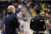 United States (USA) head coach Bob Bradley talks with a referee. The men's national teams of the United States (USA) and Colombia (COL) played to a 0-0 tie during an international friendly at PPL Park in Chester, PA, on October 12, 2010.