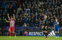 Gabi of Club Atletico de Madrid raises his arms to celebrate his teams win as Goalkeeper Kasper Schmeichel of Leicester City  & Jamie Vardy of Leicester City are left disappointed at full time during the UEFA Champions League QF 2nd Leg match between Leicester City and Atletico Madrid at the King Power Stadium, Leicester, England on 18 April 2017. Photo by Andy Rowland.