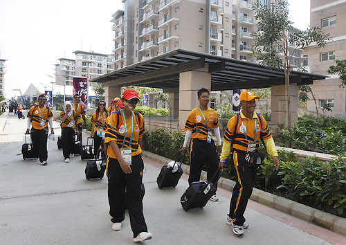 26.09.2010 Malaysian lawn bowling athletes proceed for practice from the Commonwealth Games village in New Delhi.