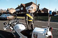 Police motorcyclist stopping speeding traffic. This image may only be used to portray the subject in a positive manner..©shoutpictures.com..john@shoutpictures.com