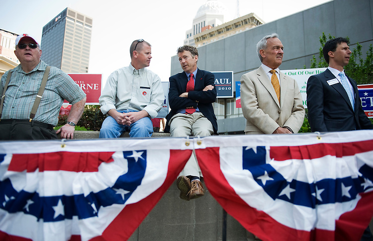 Senate candidate Rand Paul, center, waits to speak at a Tea Party in downtown Louisville, April 15, 2010.  Candidate Trey Grayson also attended but did not speak.