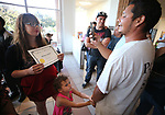 Richard Alvarado takes a photo of his wife Sabrina Combest after she received her High School Equivalency during a Western Nevada College ceremony in Carson City, Nev., on Monday, June 19, 2017. <br /> Photo by Cathleen Allison/Nevada Photo Source