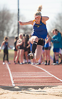 NWA Democrat-Gazette/CHARLIE KAIJO Bella Mitchell, 14, of Central Junior High long jumps during the Tiger Relays track meet, Friday, March 16, 2018 at the Tiger Athletic Complex in Bentonville.
