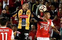 BOGOTA - COLOMBIA – 23 – 05 - 2017: Juan Roa (Der.) jugador de Independiente Santa Fe, salta a cabecear el balon con Agustin Jara (Izq.) jugador de The Strongest durante partido entre Independiente Santa Fe de Colombia y The Strongest de Bolivia, de la fase de grupos, grupo 2, fecha 6 por la Copa Conmebol Libertadores Bridgestone 2017, en el estadio Nemesio Camacho El Campin, de la ciudad de Bogota. / Juan Roa (R) player of Independiente Santa Fe, jumps to head for the ball with Agustin Jara (L) player of The Strongest during a match between Independiente Santa Fe of Colombia and The Strongest of Bolivia, of the group stage, group 2 of the date 6th, for the Conmebol Copa Libertadores Bridgestone 2017 at the Nemesio Camacho El Campin in Bogota city. VizzorImage / Luis Ramirez / Staff.