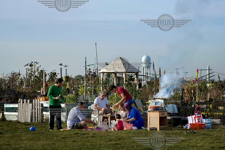 Member of the Turkish community having a barbecue next to private gardens at the former inner city airport Tempelhofen Berlin. A part of the airport's terrain was opened for the public after its closure. The area is planned to become a central location for recreational and leisure activities.
