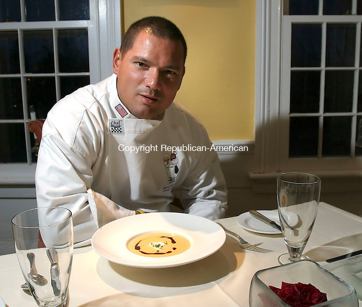 BETHLEHEM, CT,  08 NOVEMBER 2006, 110806BZ02- Jerry Reveron, owner/chef, with his puree of roasted butternut squash with Granny Smith apple creme fraiche and Syrian pumpkinseed oil at The Woodward House in Bethlehem Wednesday.<br />