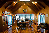 Morning at the President office. Interview with Marcus Stephen, President of the Republic of Nauru. .At the Government house, with the President office, in Yaren District...Nauru, officially the Republic of Nauru is an island nation in Micronesia in the South Pacific.  Nauru was declared independent in 1968 and it is the world's smallest independent republic, covering just 21 square kilometers..Nauru is a phosphate rock island and its economy depends almost entirely on the phosphate deposits that originate from the droppings of sea birds. Following its exploitation it briefly boasted the highest per-capita income enjoyed by any sovereign state in the world during the late 1960s and early 1970s..In the 1990s, when the phosphate reserves were partly exhausted the government resorted to unusual measures. Nauru briefly became a tax haven and illegal money laundering centre. From 2001 to 2008, it accepted aid from the Australian government in exchange for housing a Nauru detention centre, with refugees from various countries including Afghanistan and Iraq..Most necessities are imported on the island..Nauru has parliamentary system of government. It had 17 changes of administration between 1989 and 2003. In December 2007, former weight lifting medallist Marcus Stephen became the President.