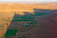shadow as sun rises over Castle Valley, Utah