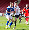 Pars' Gregor Buchanan clears from Stranraer's Sean Winter.