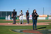 A singer performs the National Anthem before a California League game between the Lancaster JetHawks and Lake Elsinore Storm on April 10, 2019 in Lancaster, California. Lake Elsinore defeated Lancaster 10-0 in the first game of a doubleheader. (Zachary Lucy/Four Seam Images)