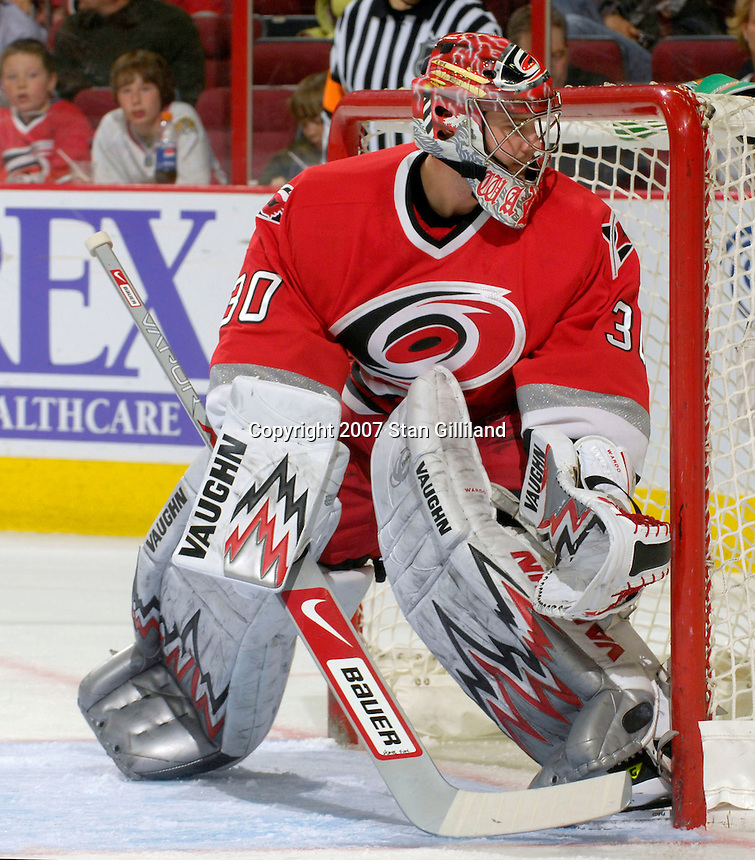 Carolina Hurricanes' Cam Ward keeps an eye on the action during a game with the Washington Capitals Thursday, March 22, 2007 at the RBC Center in Raleigh, NC. Carolina won 4-3.