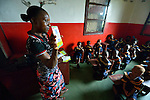 A teacher uses flash cards during class in a day care center in Monrovia, Liberia, sponsored by United Methodist Women.