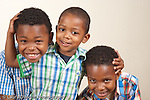 portrait of brothers ages 8, 6, and 3 years old horizontal