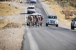 SULAIMANIYAH, IRAQ: Newroz and Dukan cycling clubs climb a hill during the individual team race.  They race on an open road with regular traffic in temperatures of over 30&ordm;C.<br /> <br /> Nyan Yassin, 24, is a professional competitive cyclist in Sulaimaniyah in the semi-autonomous region of Iraqi Kurdistan.  She is the captain of an all-female club called Newroz Club, which is the only cycling club for women in Sulaimaniyah, although there are other clubs around Iraq.  She trains and competes on roads that are badly surfaced and busy with traffic.<br /> <br /> Nyan was the first woman to start cycling in Sulaimaniyah.  She was always competitive and after trying her hand at different sports she settled on cycling.  She is now the top female cyclist in Iraq.  Her nickname is MigMig after the noise made by the cartoon character Roadrunner.<br /> <br /> Despite being clearly talented at her sport Nyan knows that in a couple of years she will have to get married and then abandon it as, in the traditional society that Kurdistan is, being a wife and a competitive sportswoman at the same time is not an option.<br /> <br /> Photo by Gona Hassan/Metrography