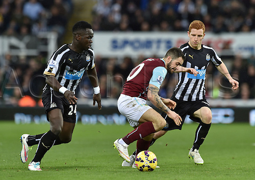 01.01.2015.  Newcastle, England. Barclays Premier League. Newcastle versus Burnley. Cheick Tiote and Jack Colback of Newcastle United closes down Danny Ings of Burnley