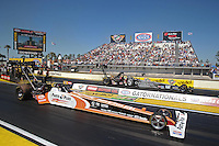 Mar. 16, 2013; Gainesville, FL, USA; NHRA top fuel dragster driver Clay Millican (near lane) races alongside teammate Bob Vandergriff Jr during qualifying for the Gatornationals at Auto-Plus Raceway at Gainesville. Mandatory Credit: Mark J. Rebilas-