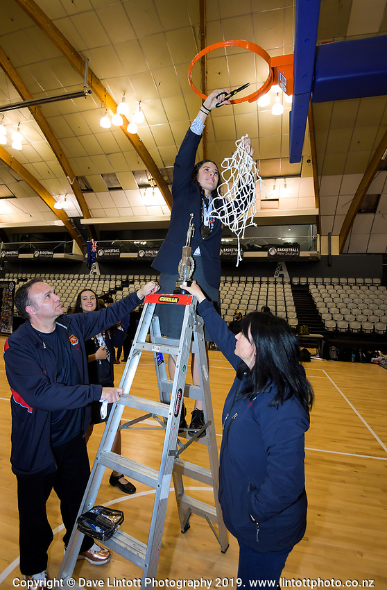 St Peters' Charlisse Leger-Walker cuts the netting after winning the 2019 Schick AA Girls' Secondary Schools Basketball National Championship final between St Peters School Cambridge and Hamilton Girls' High School at the Central Energy Trust Arena in Palmerston North, New Zealand on Saturday, 5 October 2019. Photo: Dave Lintott / lintottphoto.co.nz