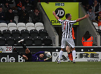 Dougie Imrie claims for a back pass as Radoslaw Cierzniak gathers the ball in the St Mirren v Dundee United Clydesdale Bank Scottish Premier League match played at St Mirren Park, Paisley on 27.10.12.