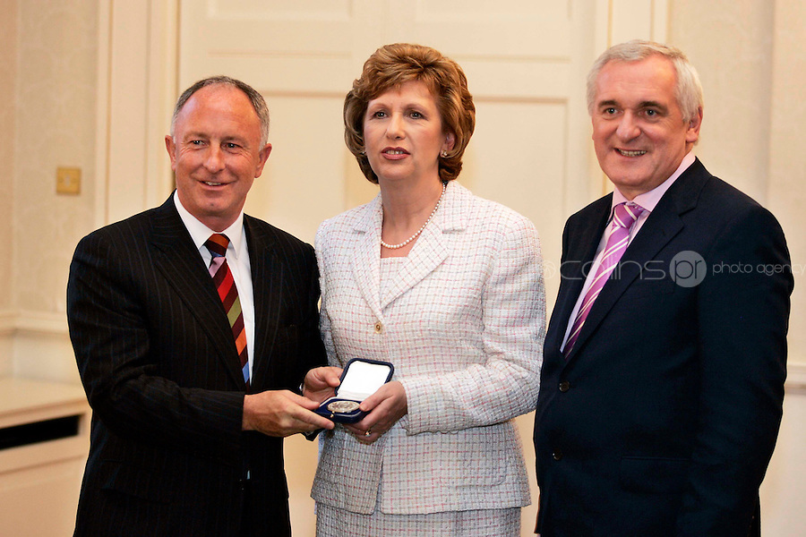 14/06/07 Minister for Foreign Afffairs, Dermot Ahern receives his seal of Office from President McAleese and Taoiseach Bertie Ahern at Aras an Uachtarain tonight....Picture Collins, Dublin, Colin Keegan.