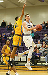 SIOUX FALLS, SD - DECEMBER 7: Drew Guebert #23 from the University of Sioux Falls takes the ball to the basket past Bryndan Matthews #23 from Concordia St. Paul during their game Friday night at the Stewart Center in Sioux Falls, SD. (Photo by Dave Eggen/Inertia)